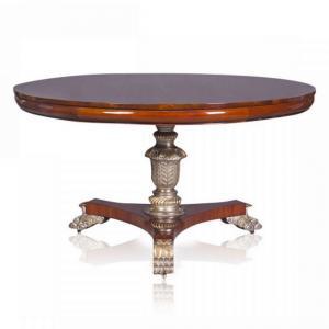 Eettafel rond mahonie met goud accenten